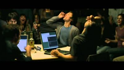 A bunch of guys getting drunk and coding
