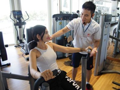 A man and woman in a gym fraternizing