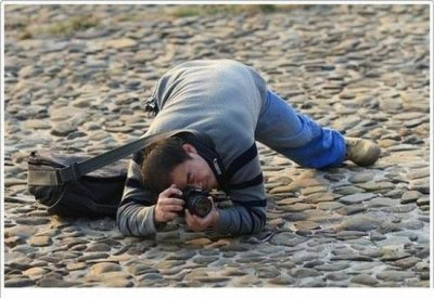 Man contorts beautifully while taking a photograph